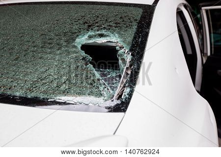 broken window of a car after accident. cracked windshield background