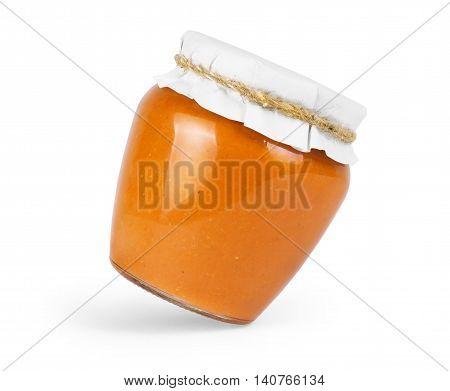 squash puree in a glass jar on a white background