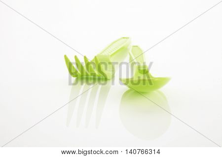 plastic spoon and fork on the white background