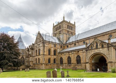 SOUTHWELL, ENGLAND - JULY 31: Southwell Minster showing the West side. In Southwell, Nottinghamshire, England. On 31st July 2016.