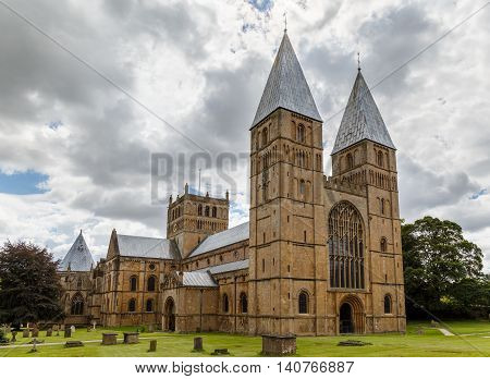 SOUTHWELL ENGLAND - JULY 31: Southwell Minster showing the West side and North side aspects. In Southwell Nottinghamshire England. On 31st July 2016.