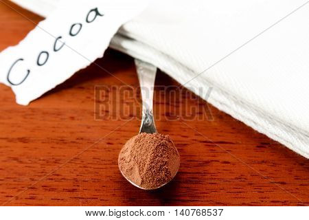 Spoon with cocoa white napkin and sign with the word