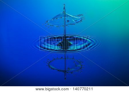 water drop collision on a blue background