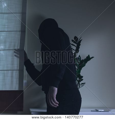 Masked Housebreaker During A Robbery