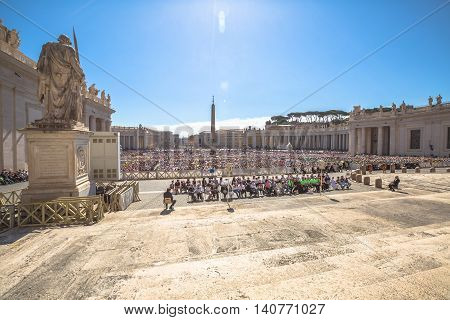 Rome, Italy - June 18, 2016: aerial view of people sitting while you listen to Pope Francesco speaking for jubilee event in St. Peter's Square, Vatican.