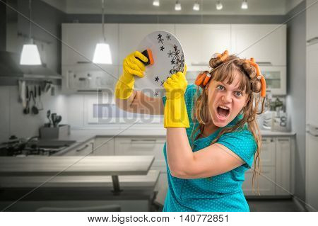 Aggressive Housewife Woman Washing Dishes In Kitchen