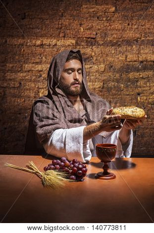 jesus christ consecrating the bread and wine
