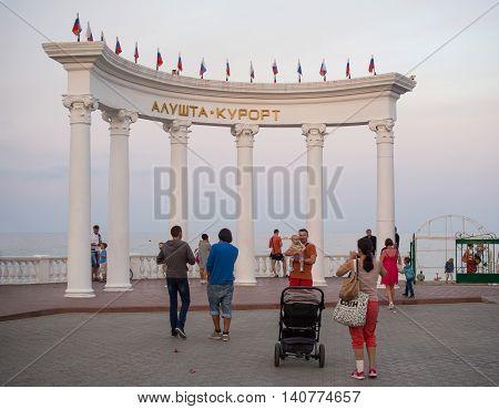 Alushta, Russia - June 01, 2016: Tourists walk in the rotunda on the waterfront of Alushta Crimea