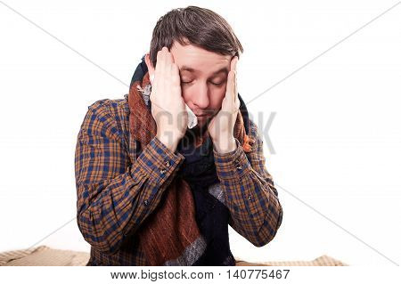 Close-up Of Man With A Migraine Holding His Temples. Isolated On White Background