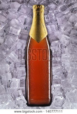 Bottle of beer with drops in ice isolated on white background.