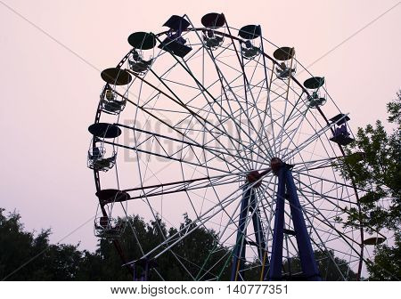 Ferris wheel on sky background in amusement park