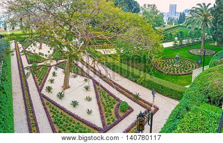 The view from the hill on the scenic geometric flower beds in Bahai Garden Haifa Israel.