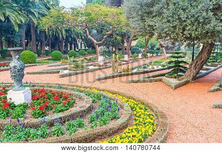 The lush trees and beautiful flower beds in Bahai Gardens Haifa Israel.