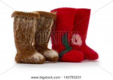Souvenir felt boots of fulled wool on a white background