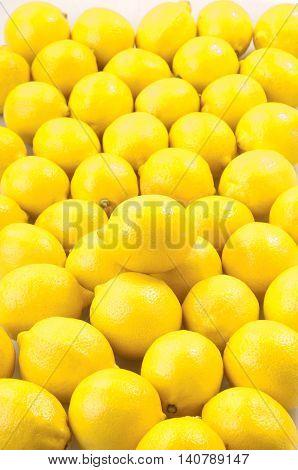 Lemon juicy summer fruit raw food on background