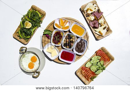 Traditional Turkish Breakfast with Eggs Benedict and Cheese Plate