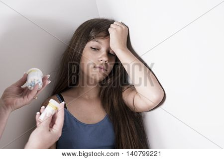 A Depressed teenager with pills thinking suicide