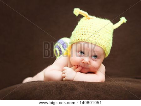 portrait of newborn with snail woolen hat