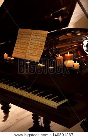 Piano with candles and music notes