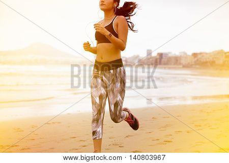 Young Female Body Running Along Beach