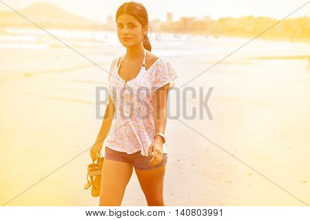Cute Brunette Girl In The Breaking Waves
