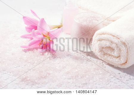 Spa setting with pink  lily flowers.  Selective focus