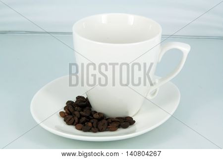 White coffee cup with coffee beans. Coffee cup.