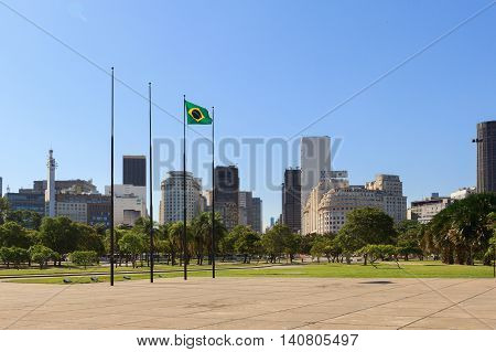 RIO DE JANEIRO - March 21: Flag of Brazil with view of City center and Gloria district on background on March 21 2016 in Rio de Janeiro