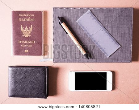 business set of white smart phone and notebook with thailand passport and balck wallet in concept new traveler