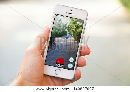 WROCLAW, POLAND - JULY 31, 2016: Popular augmented reality game Pokemon Go on the screen of Apple iPhone 5s smartphone