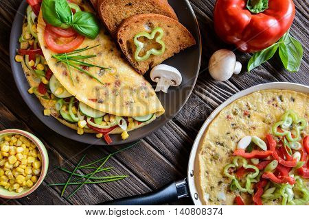Omelet With Pepper, Tomato, Corn, Green Onion, Cucumber, Mushrooms And Fried Bread