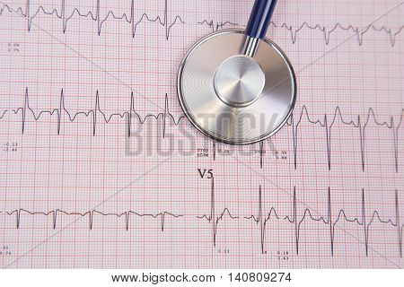 stethoscope on a cardiogram, healthy lifestyle medical