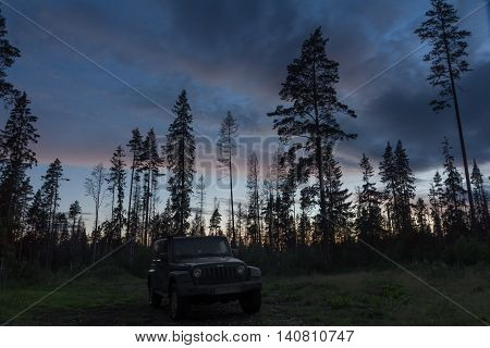 Leningrad region, Russia , July 31, 2016 , Jeep Wrangler in a pine forest on the Karelian isthmus, the Jeep Wrangler is a compact four wheel drive off road and sport utility vehicle