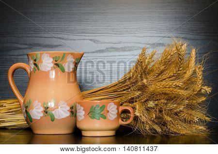 Jug mug and a sheaf on a black background