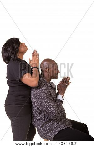 Middle aged couple praying together isolated on white