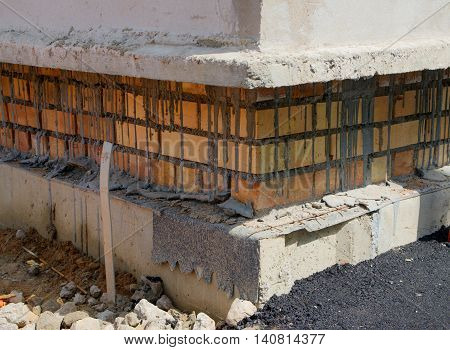 Mason bricklaying background with clay brick blocks