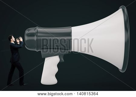 Tiny businessman screaming into huge loudspeaker on dark background. Communication concept. 3D Rendering