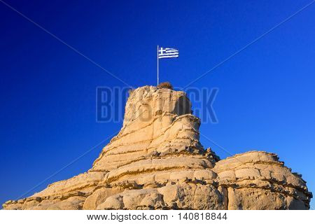 Greek flag on the rock at Zakynthos island