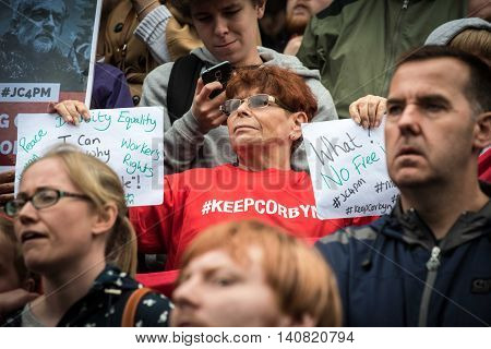 LIVERPOOL United Kingdom - August 1 2016: Jeremy Corbyn supporter hold up letters of a support at a Labour Party rally in Liverpool