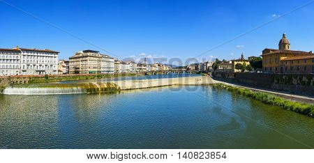 Florence or Firenze panoramic view of Arno river and Carraia medieval bridge. Tuscany Italy Europe