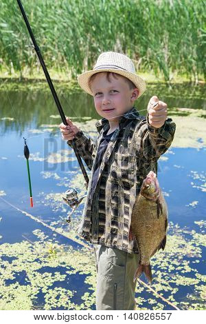 Young fisherman caught fish bream on fishing rod
