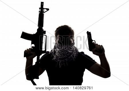 Ambiguous silhouette of a terrorist or a soldier with a rifle and a handgun