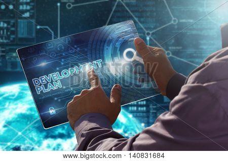 Internet. Business. Technology Concept.businessman Presses A Button Development Plan On The Virtual