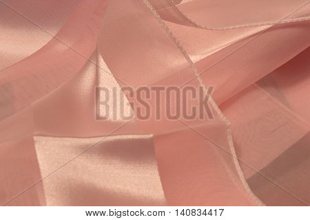 This is a photograph of Pink striped Polyester fabric scarf with sheer insert