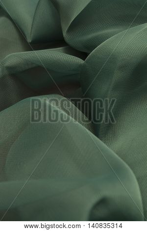This is a photograph of Green Polyester fabric