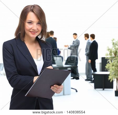 Portrait of young happy smiling businesswoman with  folder,