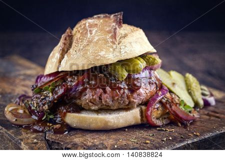 Hamburger with Chili Relish on old Cutting Board