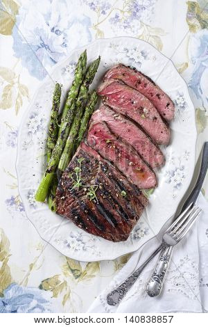Barbecue Point Steak with Green Asparagus on Plate