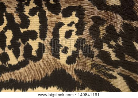 This is a photograph of an animal print polyester scarf