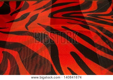 This is a photograph of a Red and Black Zebra print polyester fabric scarf